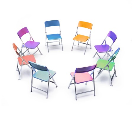 Circle of chairs of different colours LANG_EVOIMAGES