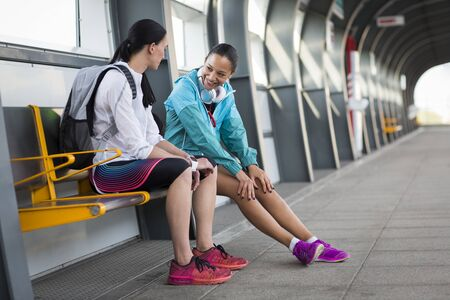 Women sitting on railway platform