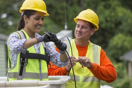 Hispanic female cable lineman