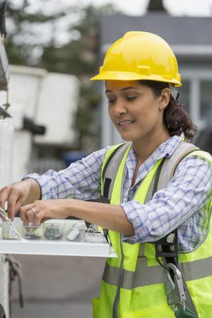 Hispanic female utility worker LANG_EVOIMAGES