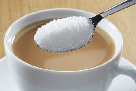 Spoonful of sugar and hot drink LANG_EVOIMAGES