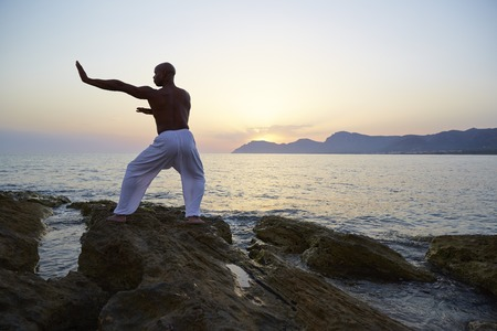Mature man doing tai chi