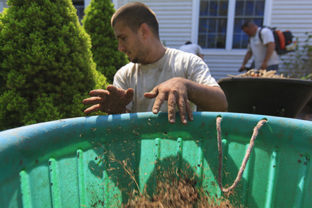cleaning crew: Landscapers at work in garden