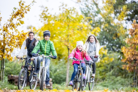 sit down: Family cycling together
