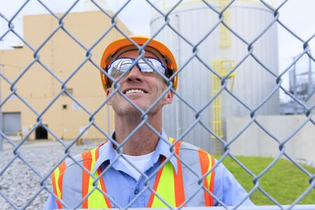 chainlink fence: Engineer working in power plant