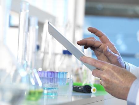 proteomics: Scientist using a digital tablet