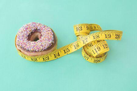 centimetres: Doughnut and tape measure