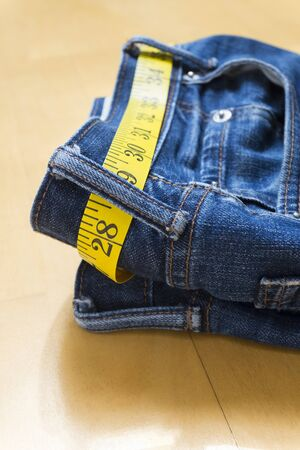 centimetres: A pair of jeans and tape measure