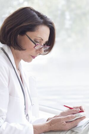 Female doctor wearing glasses with device