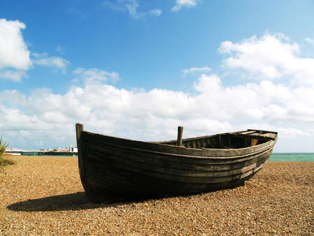 skiff: Old unusable boat on the beach
