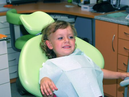 Brave little girl on dental check up Stock Photo - 8763737