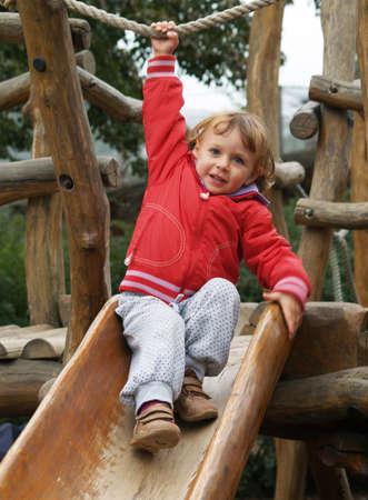 slipway: Little girl playing on wooden slipway