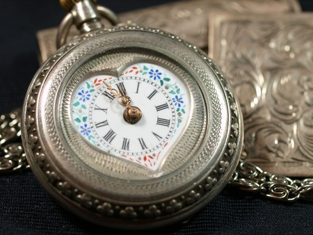Antique silver watches with painted porcelain face photo