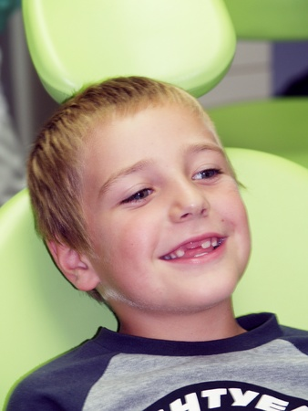 Edentulous boy on dental prevention examination Stock Photo - 8907504