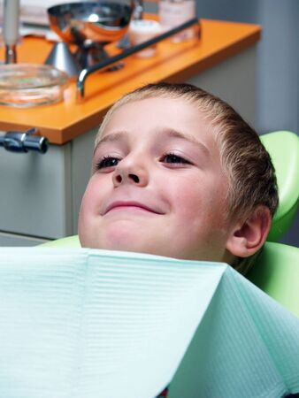Preschool boy on dental prevention examination photo