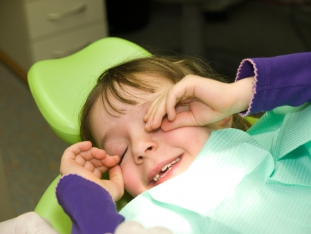 Little girl after dental examination in anesthesia