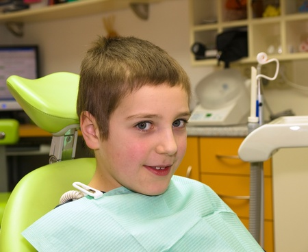 Young boy in dental chair waiting for examination Stock Photo - 9471016