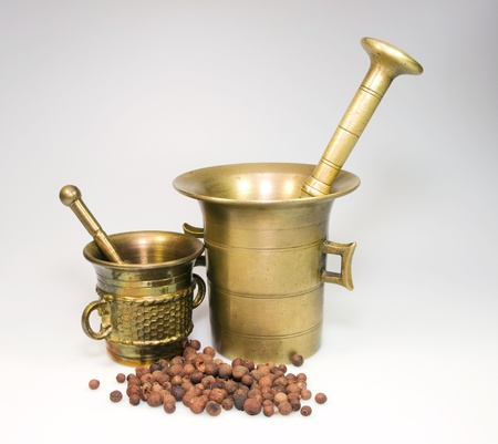 Two bronze mortars with bayberry spice