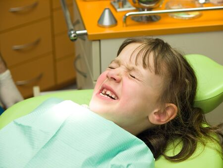 Little girl having fear of dental care Stock Photo