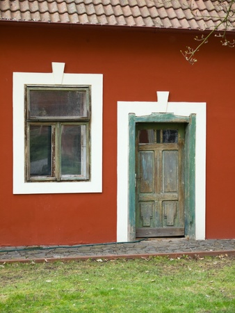 Vintage wooden door and vindow on village house in Czech republic
