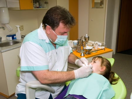 dental prophylaxis: Dentist making prevention examination to little girl Stock Photo