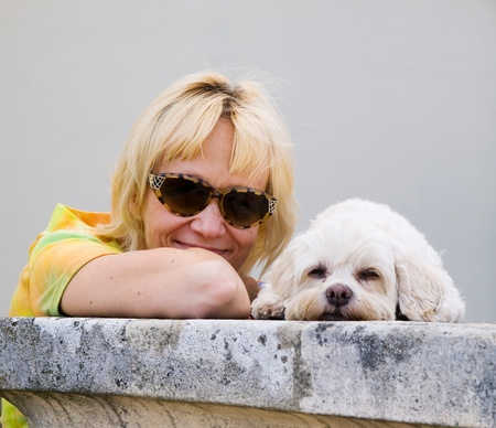 Satisfied woman with dog on summer trip