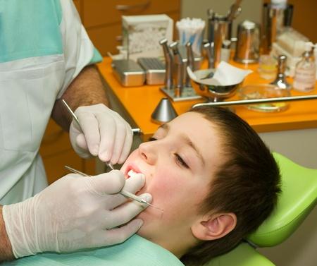 Young boy under dental examination photo