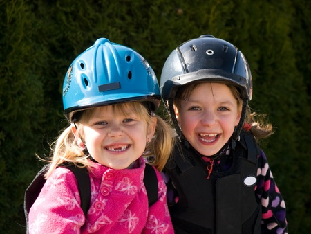 Happy girls before horse riding