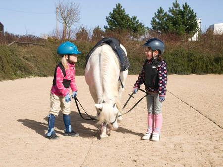 Two girls before training of horse riding Stock Photo