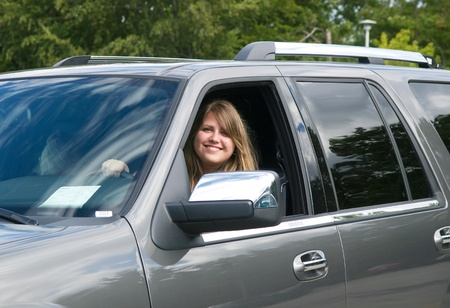 Young smiling lady drive the car Stock Photo - 11242981
