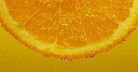 Fresh slice of orange with bubbles