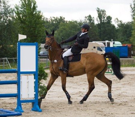 unruly: Disobediebt horse with rider on showjumping Stock Photo
