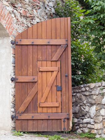 Half of open wooden gate with wicket photo