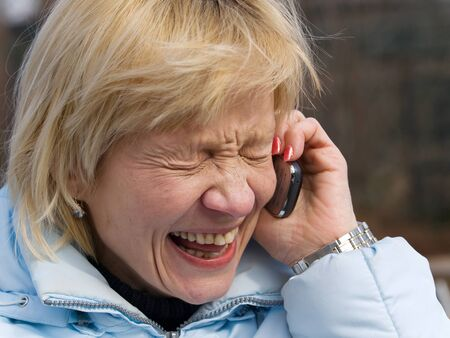 Mature lady having fun during making phone call