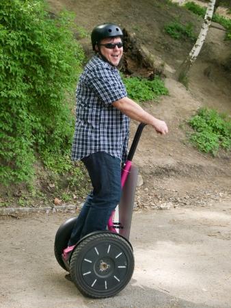 segway: Mature man driving on segway Stock Photo