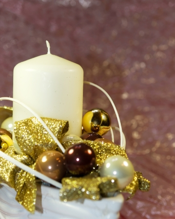 Christmas white and gold decoration with candle photo