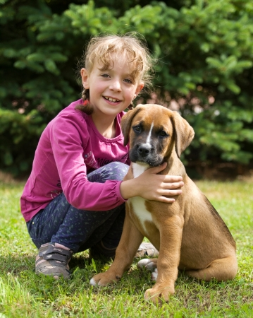 canid: Portrait of little girl with her dog