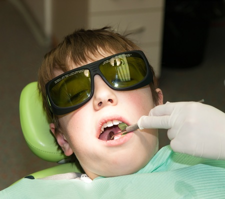 Boy during treatment in dental office photo
