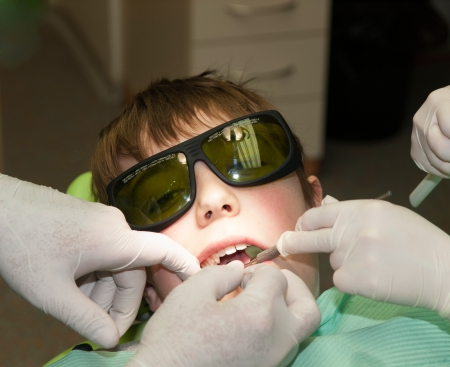 Boy with glasses in dental office photo