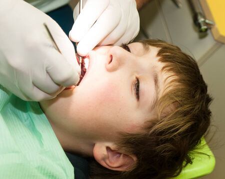 Young boy on dental examination photo