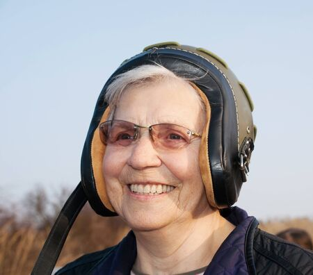 smilling: Smilling elderly lady in helmet Stock Photo