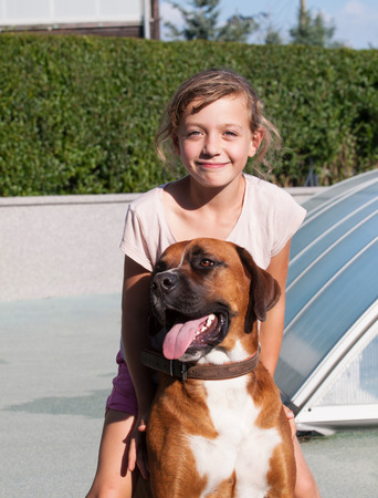canid: Young girl with her dog Stock Photo