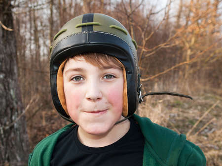 Young boy in army helmet photo