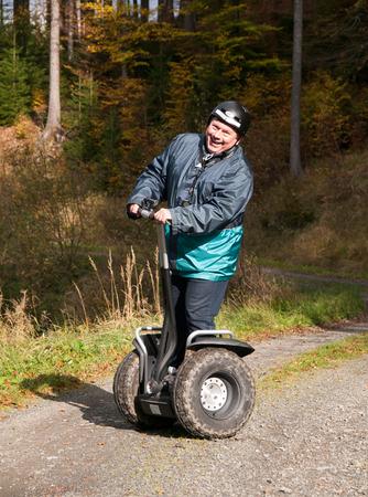 Mature man on entertainig drive on segway photo