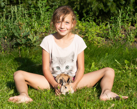 fondle: Girl playing with rabbit pet