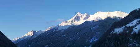 panoramatic: Panoramatic view on Stubai Alpen mountain range in morning Stock Photo