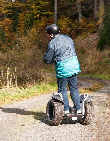 Man driving on segway in forest terrain