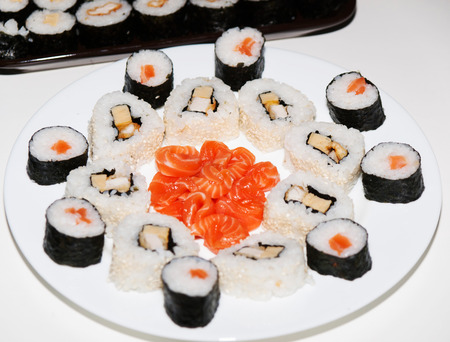 Homemade japanese sushi prepared wirh salmon and pork meat