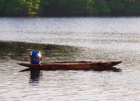 Lonesome wooden boat for fishing in sea bay in Ceylon Stock Photo