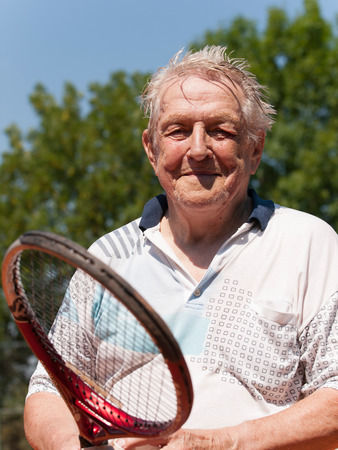 Portrait of 80 year old men after tennis match